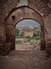 a view of Telouet village (SM Tham) Tags: africa morocco atlasmountains telouet village kasbahtelouet fortress castle arches vista buildings stone walls trees shrubs donkey