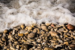 Wet rocks . . . (Dr. Farnsworth) Tags: stones rocks wet petoskey pointbetsie waves crash lakemichigan mi michigan spring march2017