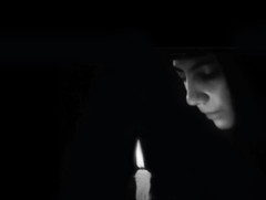 ... forgive me (j o h n n y 5) Tags: church nun christian easter pascha forgive woman candle orthodox blackwhite moody blur