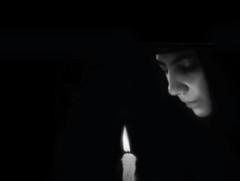 ... forgive me (j o h n n y 5) Tags: church nun christian easter pascha forgive woman candle orthodox blackwhite moody blur