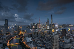 Elevated view of Shanghai skyline at dusk (HIKARU Pan) Tags: 1dx 24l asia canon canonef24mmf14lii china eos1dx huangpuriver jinmaotower lujiazui shanghai shanghaitower shanghaiworldfinancialcenter thebund architecture business cityscape clouds day downtown dusk horizontal illuminated modern nightscape noperson outdoors photography skyline skyscraper tallbuildings urban shanghaiworldfinancialcenterswfc theorientalpearlradiotvtower
