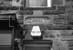 Lily Gladstone House (Man with Red Eyes) Tags: ilford harman hc110 160 115mins v850 leicam2 summicron35mmf2 iv v4 analog blackwhite monochrome silverhalide 35mm film filmisnotdead filmtillidie northumberland northumbria sign date datestone number frame lilygladstone 1903 vintage mechanicalcamera sunnysixteen delta100