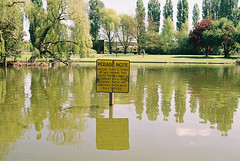 ce650 - pool notice (johnnytakespictures) Tags: park trees lake reflection green film nature water pool sign 35mm warning canon eos reflecting fishing pond fuji natural notice please young note rod fujifilm ripples analogue coventry expired rippling licence quinton c200 eos650