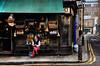 A Date With Hot Chocolate (Dimmilan) Tags: street uk england people urban london shop corner restaurant bollard oldarchitecture galleryoffantasticshots