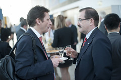 Andreas Kopp discussing with Yury Shcherbanin at the cocktail reception