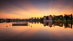 ENTEI (Scintt) Tags: morning travel light sky panorama orange sun lake reflection tourism nature water clouds sunrise garden landscape boats dawn mirror still pond singapore glow colours natural awesome wide chinese surreal twin calm symmetry clear rays oriental jurong epic stitched beams pagodas scintillation scintt