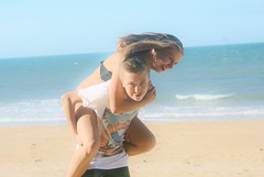 (earthly magic) Tags: ocean blue friends boy portrait people sunlight colour love beach water girl sunshine youth canon fun sand play teenagers australia highlights together laugh blonde trust queensland playful piggyback carry active