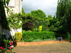 Frolles: evening sun emerging (green voyage (far, far behind, trying to catch up)) Tags: flowers trees houses france gardens evening spring vines ledefrance may bbs shrubs 18thcentury patios seineetmarne pelargoniums farmhouses pergolas parisregion lobelias frolles crcylachapelle
