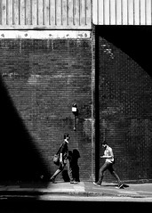 Deansgate Manchester (ClanSurik) Tags: street city people urban blackandwhite bw men monochrome contrast manchester candid streetphotography documentary highcontrast pedestrian sidewalk streetphoto capture dudes bnw blackandwhitestreetphotography surikpictures clansurik nikond5300