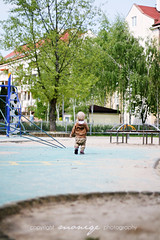 and there he goes (~moniqe~) Tags: blue boy baby playground kid toddler dof child walk perspective ~moniqe~