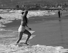 (A.C.Elliott) Tags: woman beach girl jeans shorts ricoh gxr flickrandroidapp:filter=none minolta90mmf4
