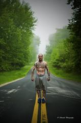 Prison Break? (TStanisch) Tags: road trees portrait man tree fog tattoo long foggy tattoos flex longroad manhood flexing