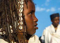 Dabale age grade boy during the Gada system ceremony in Borana tribe, Oromia, Yabelo, Ethiopia (Eric Lafforgue) Tags: 67years africa badhaasa boran borana borena celebration ceremony child colourpicture culturalheritage dabale dreadlocks eastafrica ethiopia ethiopia0317220 gaada gada gadasystem gadaa haircut hairstyle head headshot headwear horizontal hornofafrica oromia oromiya oromo oromya outdoors shells sideview traditionalculture tribalculture twopeople unesco yabello yabelo et