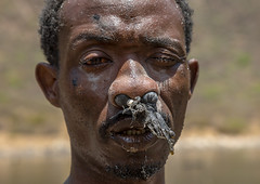 Borana tribe man with protection in his nose ready to dive in the volcano crater to collect salt, Oromia, El Sod, Ethiopia (Eric Lafforgue) Tags: adult africa african blackpeople borana colourpicture country crater danger dangerous day developingcountry elsod ethiopia ethiopia0317052 ethiopian ethnic extinctvolcano hardwork head headshot horizontal hornofafrica lake lookingatcamera maturemen men naturalphenomenon onemanonly oneperson oromia oromo oromya outdoors protection realpeople resources saline salt saltlake sod toxic tribe volcanic volcano water worker