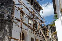 scaffolding, african style (sixthofdecember) Tags: travel africa eastafrica tanzania zanzibar zanzibarisland island stonetown city urban town outside outdoors nikon nikond5100 tamron tamron18270 building buildings sunshine sunny sky house scaffold scaffolding