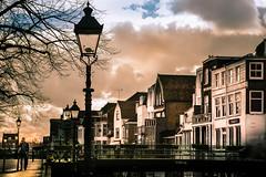 visbrug Gorinchem (bjdewagenaar) Tags: city street streetphotography lamppost buildings old century clouds sky sun tree people urban bridge colors sony a58 alpha minolta 28135mm secret handshake raw lightroom photoshop