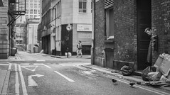 Watching (kungfuslippers) Tags: blackandwhite mono streetphotography manchester backstreets alleyway