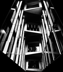 Entrapment - London City Architecture by Simon & His Camera (Simon & His Camera) Tags: architecture contrast window city urban building bw blackandwhite black white london lines squares abstract dark geometric lookingup light monochrome metal pattern passage simonandhiscamera vignette vertical