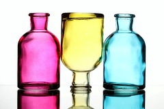 Three (Karen_Chappell) Tags: three 3 pink blue yellow white pastel bottle glass bottles reflection colourful multicoloured colours colour stilllife