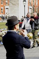 (paul.comstock) Tags: manhattan nyc newyork february 2017 feb2017 urban digital digitalphotography digitalphotograph canons120 canon s120 8feb2017 wednesday washsqpark washingtonsquarepark musician trumpetplayer trumpet couples smartphone cellphone arch