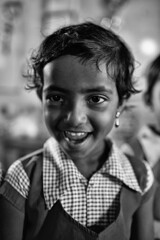 The Charismatic (alisdair jones) Tags: ef35mmf14lusm girl child portrait school uniform nainativu srilanka