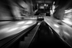 escalator drive... Rolltreppenlauf... (Benny aka WortLichtMaler) Tags: blackwhite schwarzweis schwarz weis black white mall shopping center loop5 langzeitbelichtung samyang 14mm