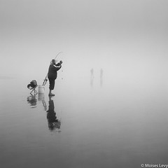 Fishing in the fog (Moises Levy L) Tags: blackwhite film fishermen fog northwest northwest2009 oregon red1 siluetas square usa beach hasselblad
