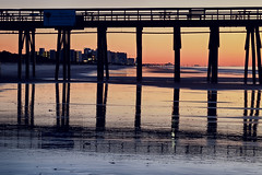 Myrtle Beach Morning (matthewkaz) Tags: pier silhouette myrtlebeach sunrise myrtlebeachstatepark statepark myrtlebeachstateparkpier myrtlebeachpier ocean atlanticocean water sc southcarolina beach shore shoreline coast coastline buildings reflection reflections 2017 longexposure