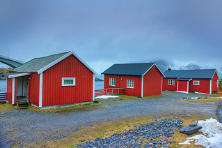 Travel Concepts and Ideas. Classic Red Houses In One of the Streets of Traditional Norwegian Fishing Hut Village Hamnoy in Norway.