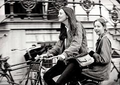 On the Bike (Clare-White) Tags: street candid bike girls 2 laughing amsterdam bw