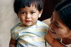 19-690 (ndpa / s. lundeen, archivist) Tags: portrait people woman color film face 35mm thailand child faces bangkok candid nick mother grandpalace thai 1970s 1972 19 youngwoman 1973 motherandchild dewolf nickdewolf photographbynickdewolf reel19