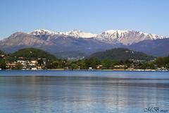 Blue Lugano (maureen bracewell) Tags: blue italy lake snow mountains water reflections landscape switzerland spring lugano 2014 fantasticnature