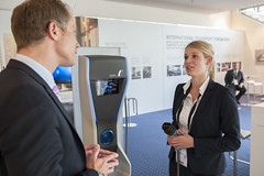 Carolin Müller discusses with the visitor, at the BMW stand