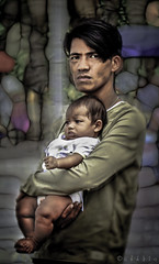 Too soon a father (FotoGrazio) Tags: poverty family baby hug child sad wayne father small philippines poor dirty manila malate cuddle teenager hungry desperation enfant manilabay hold grazio sandiegophotographers fotograzio
