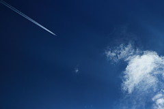 Off to the sun (peterned) Tags: blue sky june clouds plane canon eos explore 7d polarizer chemtrails 2014 1755mm