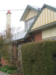 Window and Gable Detail of the Former Dental Surgery of Doctor L. C. Bayer - Corner Gellibrand and Dennis Streets, Colac (raaen99) Tags: city chimney house building brick tower home stone architecture facade architecturaldetail queenanne masonry australia stainedglass victoria surgery artnouveau porch villa verandah nouveau 1910s residence dentist 20thcentury 1915 legacy stainedglasswindow edwardian stucco gable colac halftimbered 1900s redbrick jugendstil dentalsurgery countryvictoria baywindow belleepoque legacyhouse domesticarchitecture twentiethcentury bellepoque architecturalfeature roughcast queenannestyle brickandstone architectunknown queenannearchitecture gellibrandst dennisstreet edwardiana provincialvictoria brickveneer gellibrandstreet dennisst federationqueenanne federationqueenannearchitecture returnverandah stuccoedbrick artnouveaustainedglass architecturallydesigned artnouveaustainedglasswindow federationqueenannestyle drlcbayer doctorbayer
