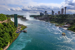 Niagara Falls - 60 (www.bazpics.com) Tags: bridge light usa newyork canada color colour fall nature water night river landscape flow niagarafalls boat waterfall rainbow scenery ship unitedstates natural drop tourists niagara falls american