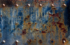 Emergence (Junkstock) Tags: aged abandoned abstract abstraction blue color corrosion corroded decay decayed distressed arizona iron industrial industry machinery machine old oldstuff patina paint peelingpaint railroad relic rivets rust rusty rustyandcrusty rusted textures texture transportation transport trains train weathered