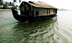 Silent sail (Shrayansh Faria Photography) Tags: boat waters backwaters houseboats trees lush green sky tropical shades shadows