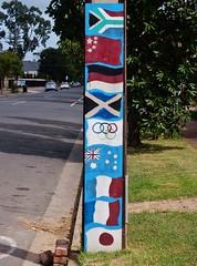 South African Flag On Top (mikecogh) Tags: glenelg stobiepole telegraphpole flags publicart vanuatu fiji japan designs southafrica