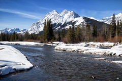 River Flow (Canon Queen Rocks (1,310,000 + views)) Tags: mountains snow snowcapped winter ice melt water river trees sky scenery scenic nature landscape alberta clouds canada