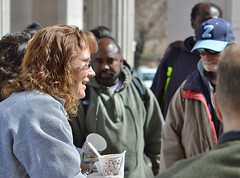 A volunteer from a local church group serves lunch to the needy at Civic Center Park in Denver. (desrowVISUALS.com) Tags: economics economy poverty poorpeople austerity economiccrisis poor service compassion love luncheschurch setfreechurch freelunch