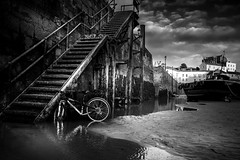The Practicality Of Youth (garethleethomas) Tags: bike youth young child blackandwhite mono monochrome harbour uk life contrast art arty story