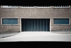 Edward Street (Delay Tactics) Tags: sheffield shutter windows bricks wall blue panorama film eyes entrance