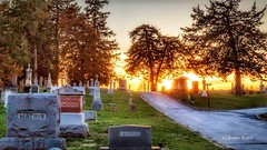 Light At The End Of The Road (Justin Loyd Photography) Tags: cemetery perry iowa violethill sunset sunlight sun evening flickr photography canon6d 24105l april spring colorful grave headstone