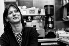 smoking and laughing (Olafs Osh) Tags: bw woman white black coffee girl smile bar night drunk work mono cafe drink smoke chill barmaid