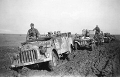 A FlaK unit Kfz.70 Steyr 1500A/01, followed by two Sd.Kfz.10 FlaK 38 vehicles in the Ukraine, 1942.