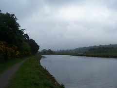 """Walking in the rain"", Caledonian Canal, Inverness, May 2014 (allanmaciver) Tags: family wet water rain misty dark canal warm long track riverside thomas walk calm telford company genius engineer atmospheric menace inverness muggy caledonian allanmaciver"
