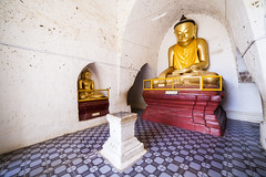 Buddha Shrine. (Ollie Smalley Photography (OSP)) Tags: old blue light red orange white distortion travelling tourism yellow architecture contrast canon lens temple gold golden pagoda shrine asia southeastasia pattern burma buddhist details buddhism wideangle arches landmark historic tiles walkway 5d myanmar walls iconic canoneos f28 bagan buddhashrine travelphotography ultrawideangle 14mm samyang arhway 5d2 5dii canon5dmarkii baganplains samyang14mmf28mf