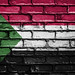 National Flag of Sudan on a Brick Wall